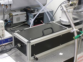 Image of the measurement setup showing the spectrograph and ICCD camera in the background